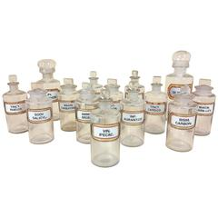 Set of 14 Early 20th Century Pharmacy Glass Jars with Rebated Gilt Labels