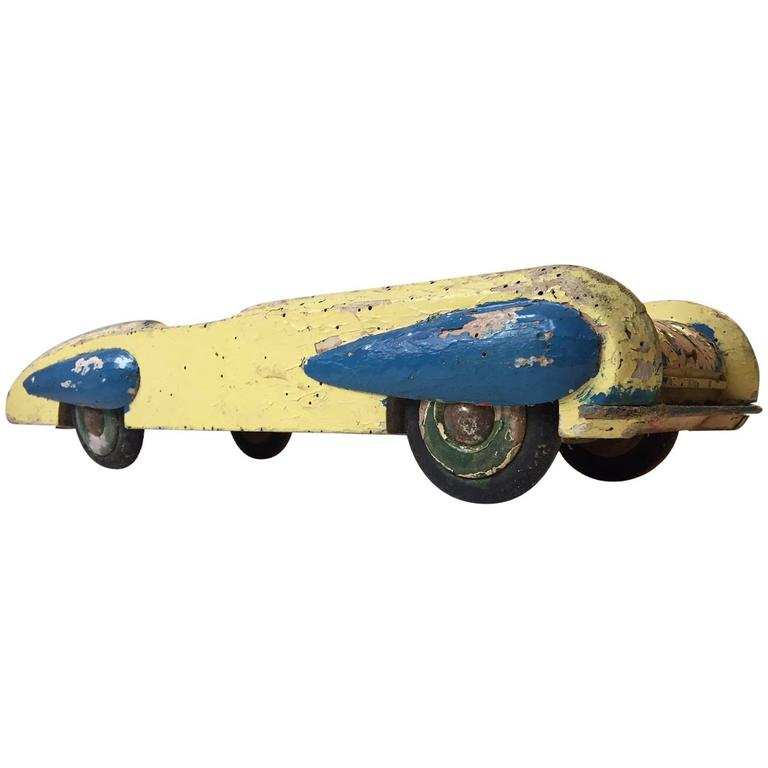 Unique, Decorative & Rustic 1930s Streamlined Wooden Toy Car with Dunlop Tires For Sale