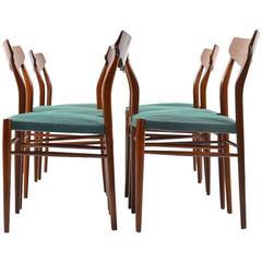 Set of Ten Mid-Century Teak Dining Chairs by Luebke