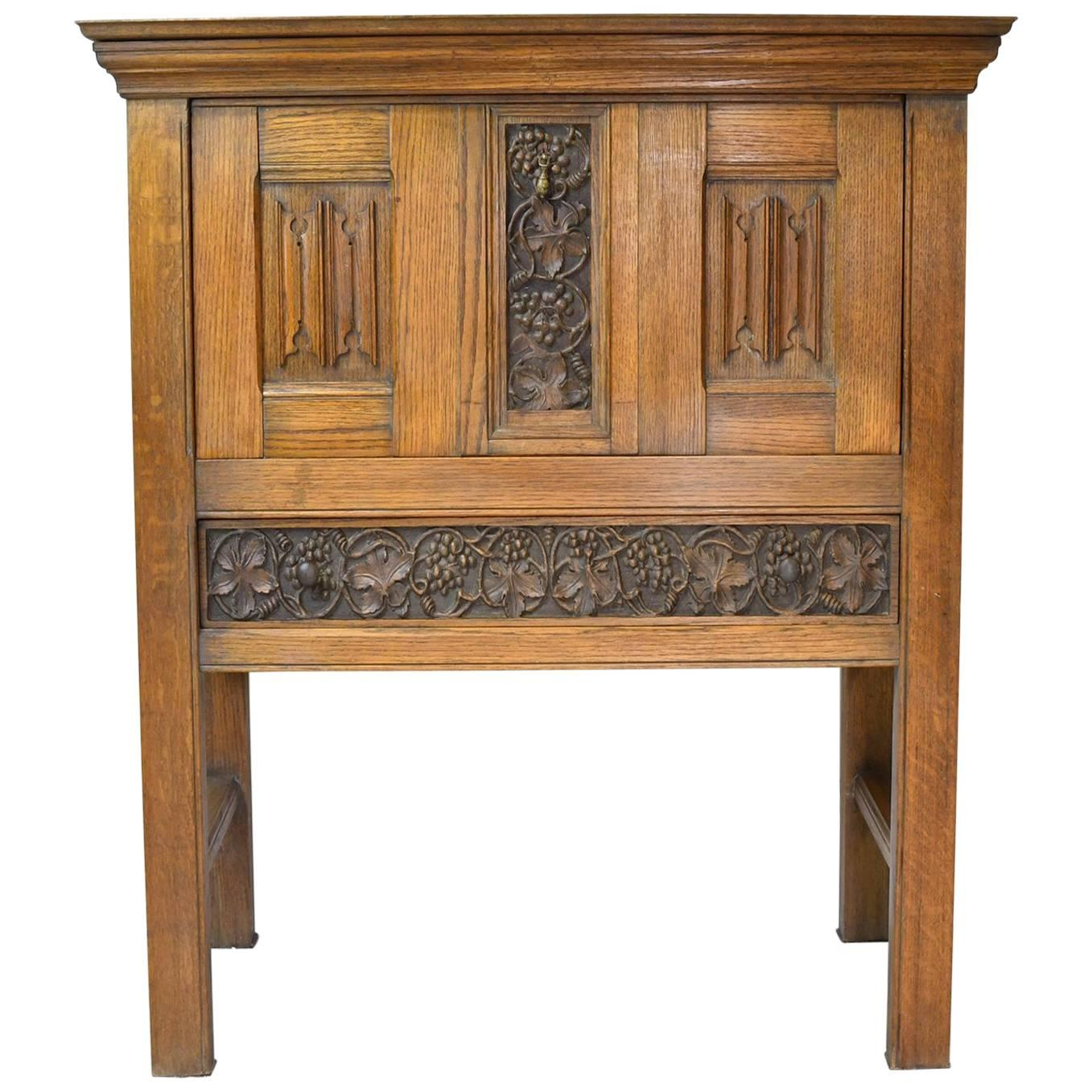 Early 20th Century Arts & Crafts Bar Cabinet in Oak with Carved Panels
