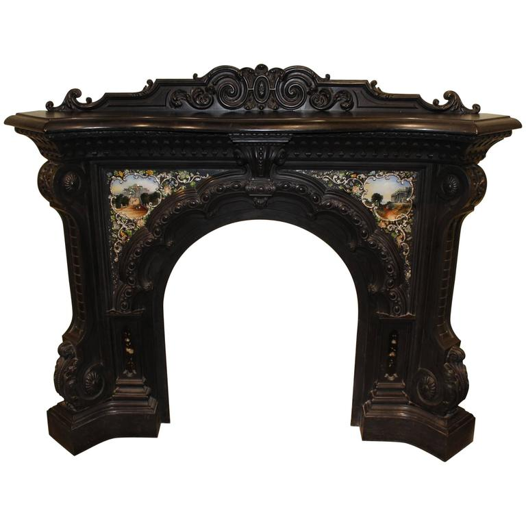 For Sale on 1stdibs - An exceptional cast iron fireplace serpentine form mantel and surround