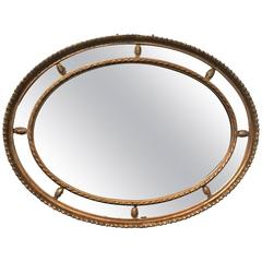 Early 20th Century Oval Segmented Gilt Mirror
