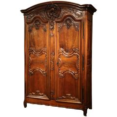 Important 18th Century French Louis XV Carved Walnut Armoire from Lyon