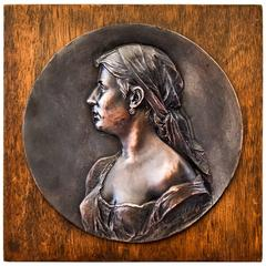 Bronze Relief on Wood