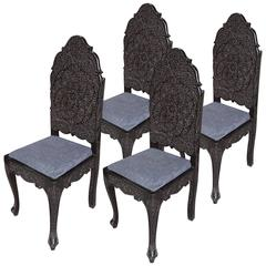 Set of Four Intricately Carved Ebony Hall Chairs