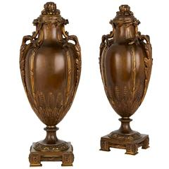 Pair of Gilt and Patinated Bronze Lidded Antique Vases