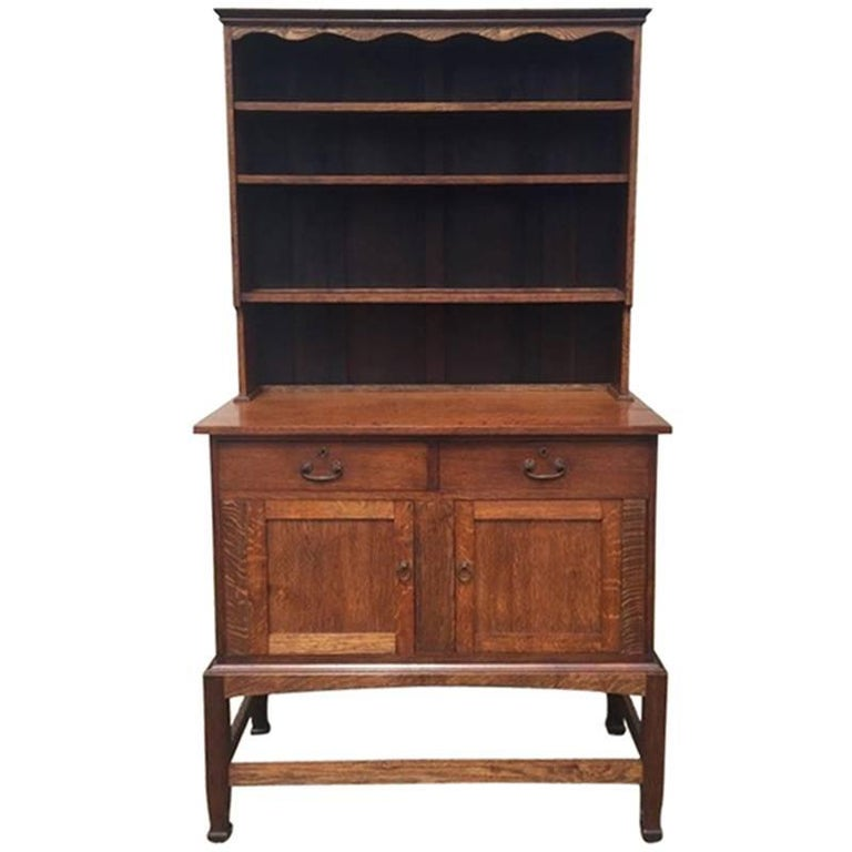 An Arts & Crafts Craftsman made simple Oak Dresser with Decorative Shaped Top  For Sale
