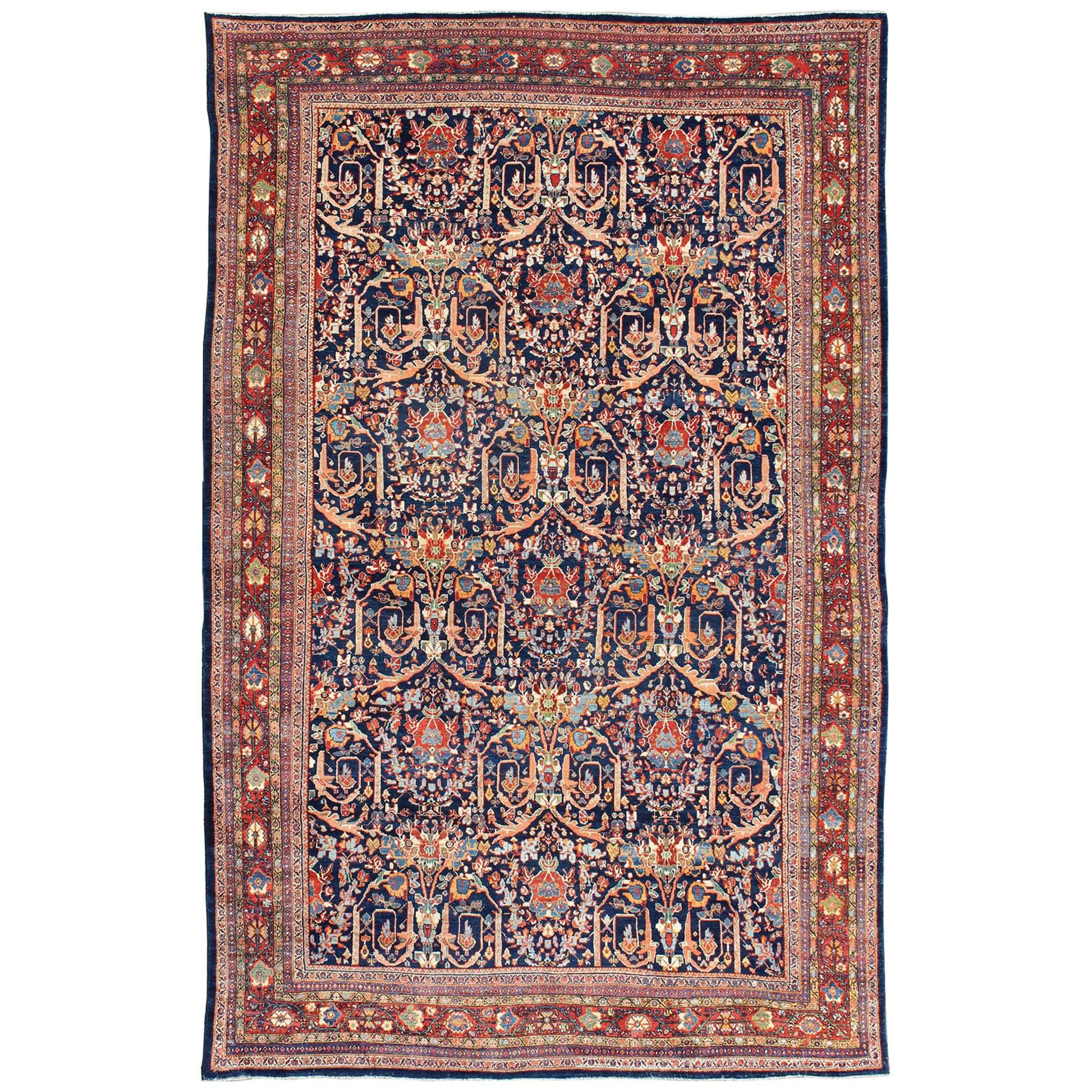 Large Antique Persian Sultanabad Rug in Blue Background in Multi Colors