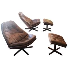 Pair of Leather Lounge Chairs and Ottomans by Madsen and Schuber