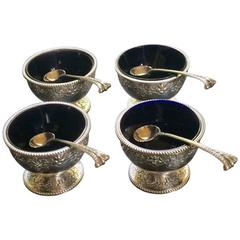 Set of Four Silver Salts Complete with Their Original Spoons by Robert Hennell