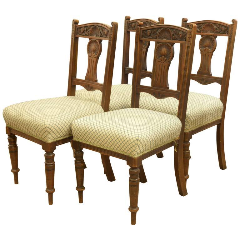 set of four edwardian walnut dining chairs 1
