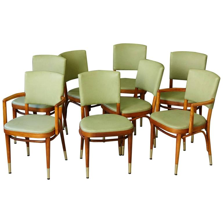 set of eight thonet maple bentwood chairs in pastel green and brass sabots 1