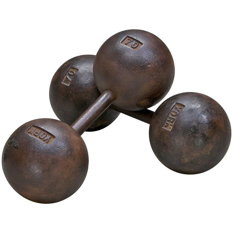 Early Century Globe Dumbbells by York Cast Iron 70lbs. Each