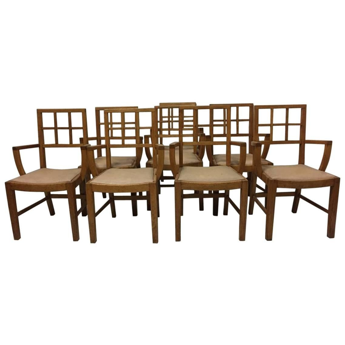 Heals of London Attri, A set of 8 Lattice Back Oak Arts & Crafts Armchairs