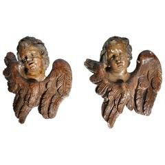 Pair of Italian Painted Putto Masks with Wings