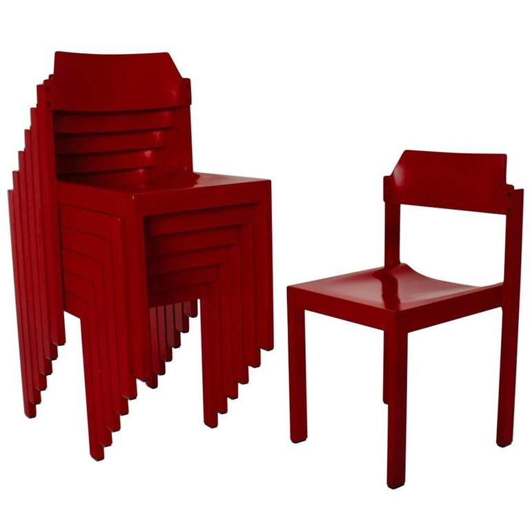 A Set of seven cherry red lacquered Dining Room Chairs, which were made of beechwood and also the set of beech dining room chairs features a moulded plywood seat. So the seating comfort of these stackable dining chairs is very well.  The original