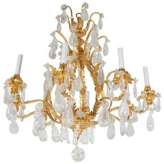 A Louis XV Style Cage Form Gilt and Rock Crystal Chandelier