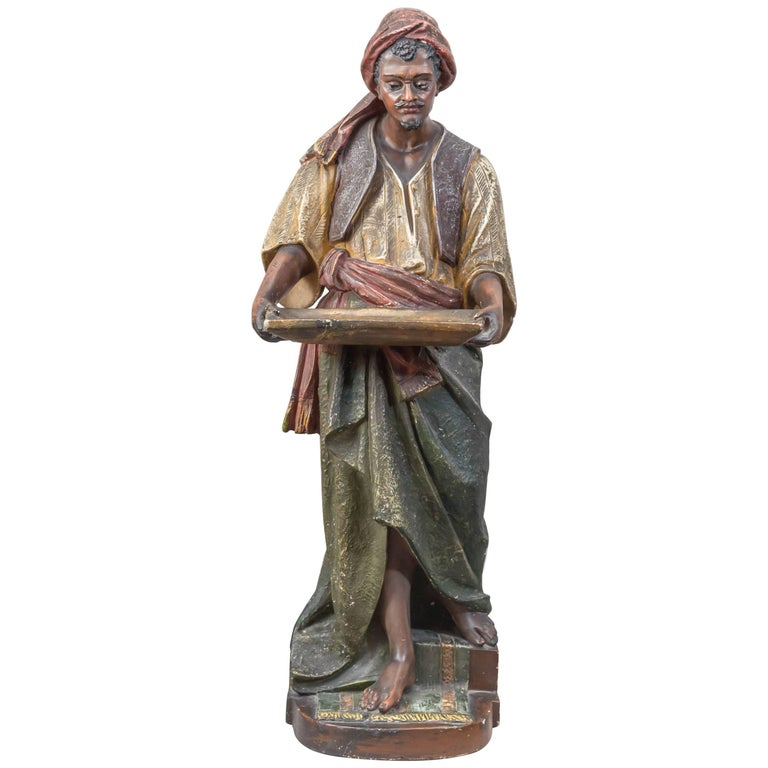Large Plaster Sculpture of an Arab Merchant Holding a Tray For Sale