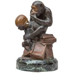 Whimsical Bronze Figure of a Monkey Studying a Skull, Darwinian Reference