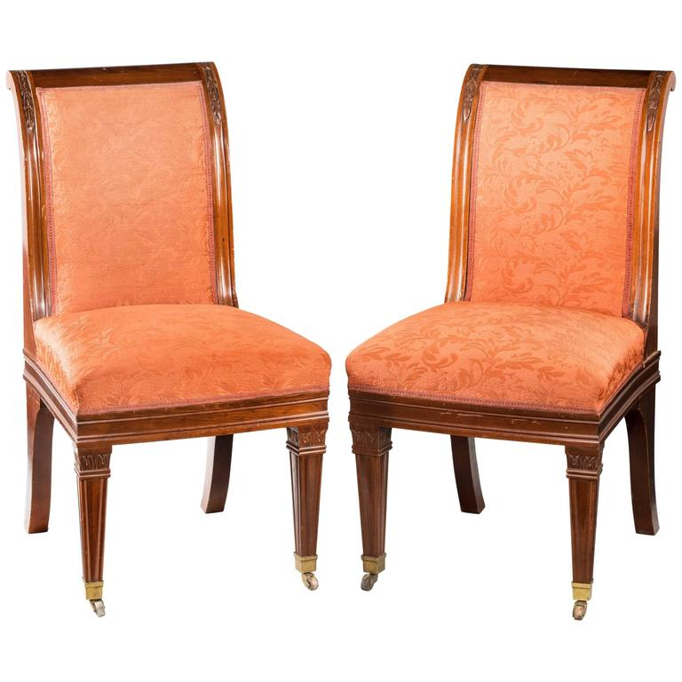 Pair of Early 20th Century Mahogany Hall Chairs in the Empire Style