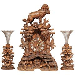 Important 19th Century Swiss Black Forest Carved Walnut Three-Piece Clock Set