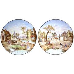 Pair of Early 20th Century French Hand-Painted Faience Wall Plates