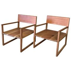 Leather Back Readers, a Pair of Armchairs by Max Greenberg for Works Progress