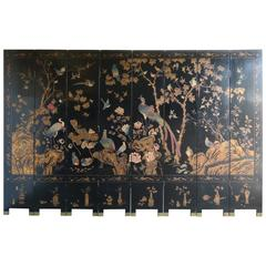 Eight-Panel Black and Gold Lacquered Chinese Screen