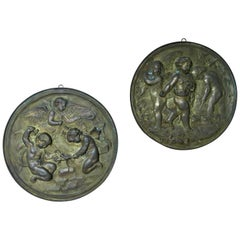 Pair of 19th Century Angels at Work Brass Repousse Decorative Rounds