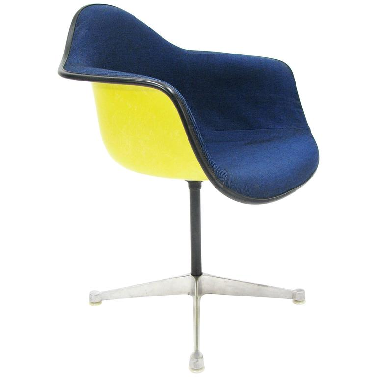 Iconic mid century upholstered eames pac fiberglass chair for Iconic mid century modern furniture
