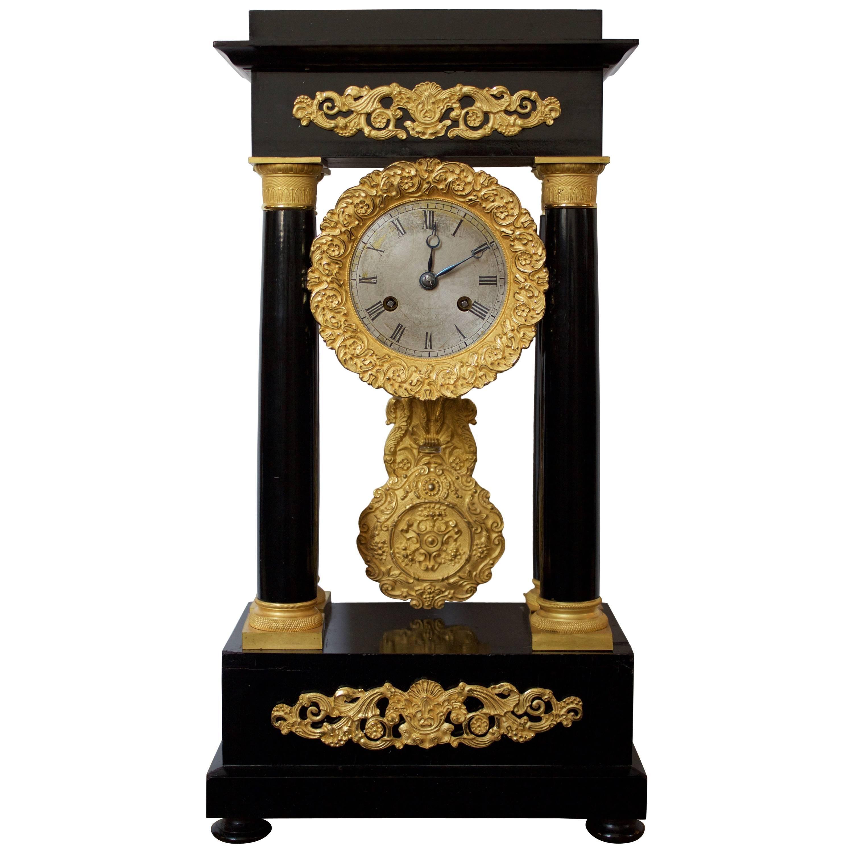 Early 19th Century Ormolu and Ebonized Wood Empire Portico Clock