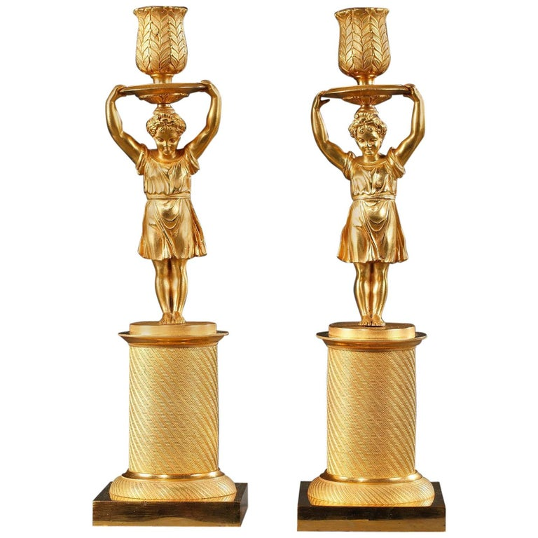 Early 19th Century Pair of Candlesticks in Gilt Bronze
