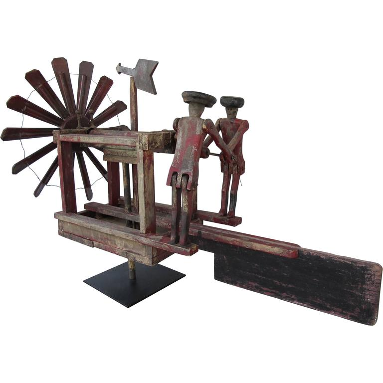 Whirligig with Propeller and Two Men in Hats Pumping For Sale