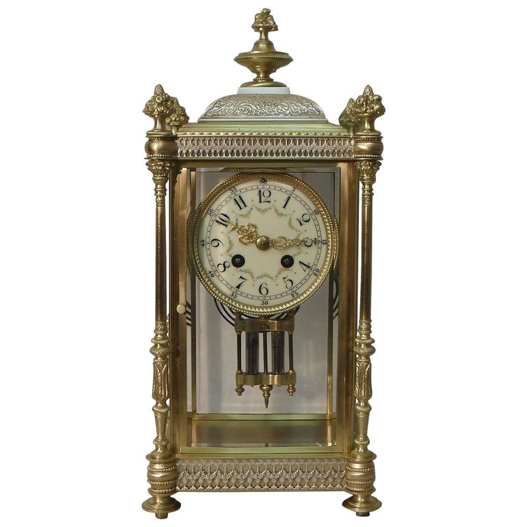 French Belle Epoque Brass and Silver Gilt Four Glass Mantel Clock