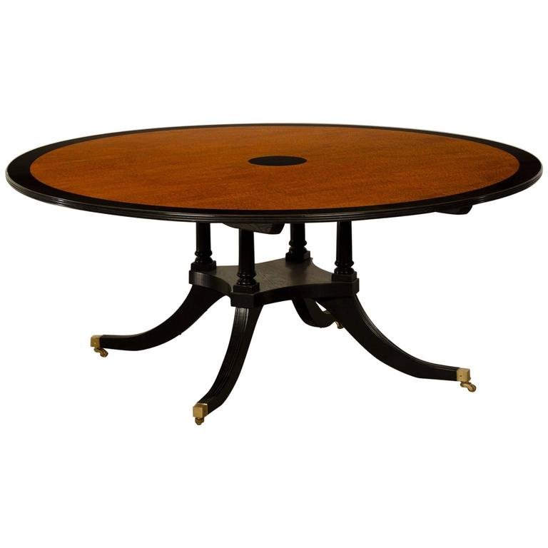 English Sheraton Style Round Dining Table Featuring Pomelle Sapele Top For Sale