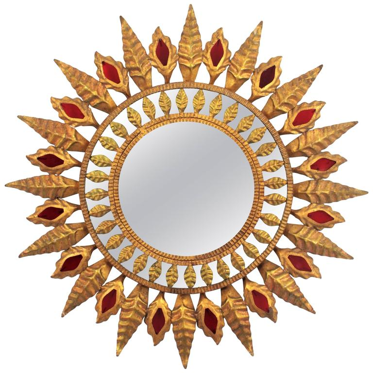 Spanish 1960s Hollywood Regency Gilt Iron Sunburst Mirror with Red Glass Accents For Sale