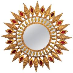 Spanish 1960s Hollywood Regency Gilt Iron Sunburst Mirror with Red Glass Accents