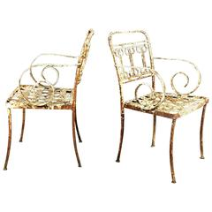 Pair of Late 19th Century American Iron Scroll Arm Garden Chairs