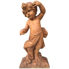 Early 19th Century French Hand-Carved Nutwood Putto Boy Sculpture