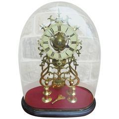 Antique Skeleton Clock under Glass Dome