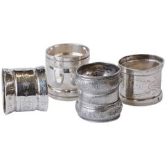 Four Late Victorian, Three Sterling and One Silver Plate Napkin Rings