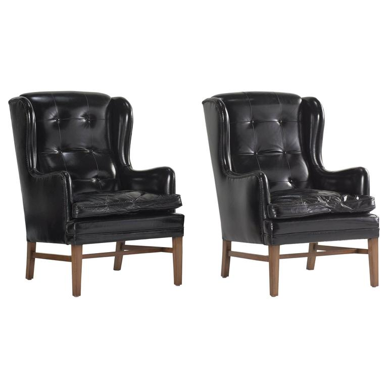 Black Leather Wing Armchairs, circa 1950 For Sale