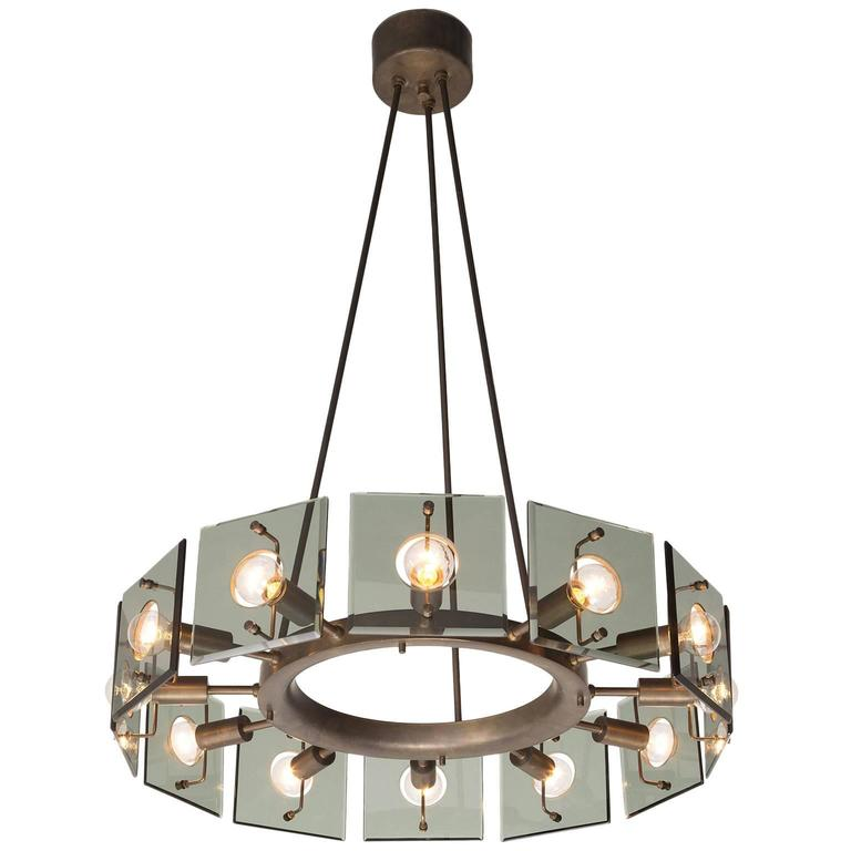 round metal chandelier shaped brass metal and glass chandelier for 2013