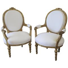 Pair of 20th Century Carved Giltwood French Chairs