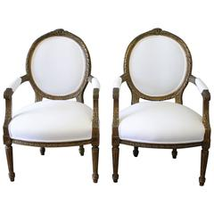 Pair of 19th Century Giltwood Ribbon Carved Louis XVI Style French Chairs