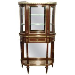 French Mahogany Bow Ended Glazed Vitrine with Mirror Back Attributed to Sormani