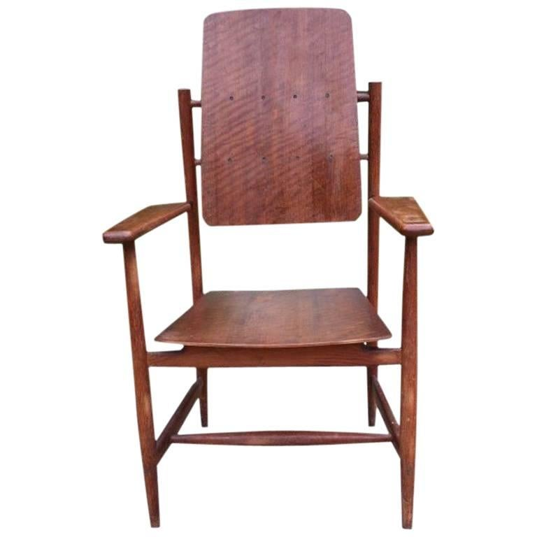 A Scandinavian Style Designer Solid Oak Armchair with a Laminated Back and Seat.