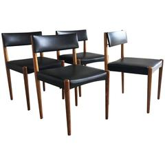 Set of Four 1970s Mid-Century Teak and Black Vinyl Dining Chairs