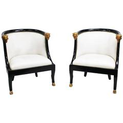 Pair of Neoclassic Black Lacquer and Gilt Rams Head Barrel Back Chairs
