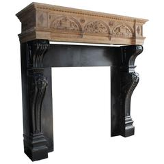 Antique Marble Fireplace with a Wooden Mantel on Top